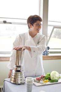 Certified Nutritionist Lisa Schmidt at work helping clients heal